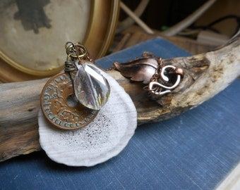 FOREST OF THIEVES. Deer antler, vintage coin and antique crystal necklace with copper Leaf Emblem fancy clasp