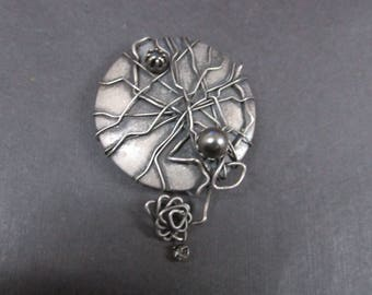 Modernistic brooch with faux pearls and rhinestone