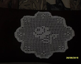 small doily with crocheted rose