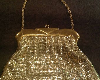 Vintage whiting & Davis gold mesh purse with satin interior and a round mirror
