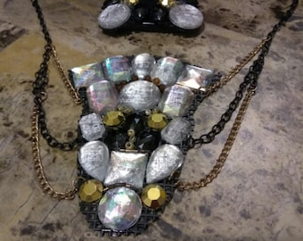Crystal, black, and gold statement necklace set