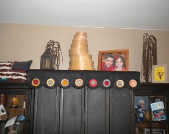 """Shelf scarf measures 36"""" long and has penny circles on the hanging edge."""