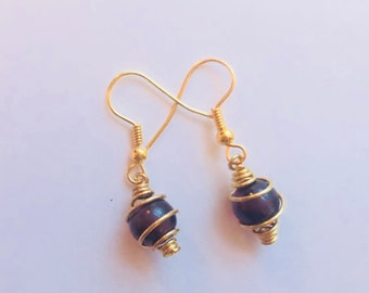 Mini gold cage earrings with black violet stone