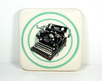 tile with a blue green pinstripe bullseye and a Royal typewriter print, ready to ship