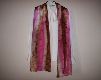 Hand painted, approximately 14 x 72 inch, 100% silk scarf in light and medium brown and pink.