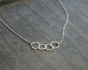 Four Entwined Circles Necklace / Tiny Silver Linked Hammered Infinity Rings on a Sterling Silver Chain .. tiny interlocking eternity circles