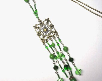 Necklace necklace Crystal beads and green glass, string and print bronze - coloured Collection