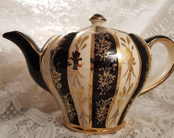 Vintage English black gold and white teapot