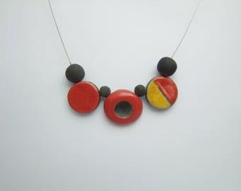 raku ceramic necklace red yellow and black