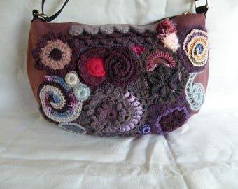 handbag with freeform crochet embellishment