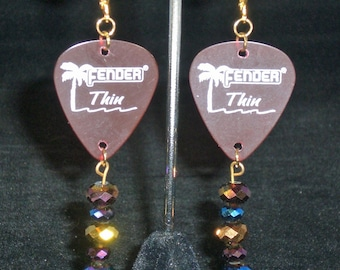 Earrings, dangle, light red guitar pick with multi colored beads