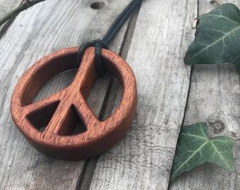 Handmade Mahogany peace-necklace by Wriliyas