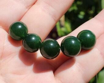 2 round Emerald beads faceted 10-11MM dark green. AR *.