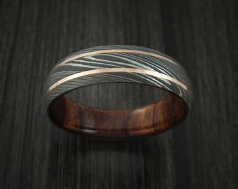 Damascus steel and 14k rose gold band with desert ironwood burl sleeve custom made
