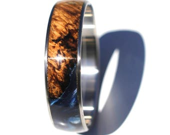 Handmade woodturned Amboyna Burl & Blue Resin Bangle Bracelet on stainless steel core.