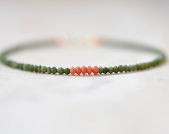 matte green jade beaded bracelet with coral. thin string like beaded bracelet. stackable thin jade and coral bracelet