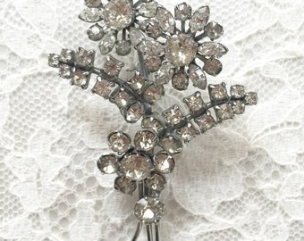 A beautiful vintage paste brooch with 3D flowers and foliage, probably 1950s