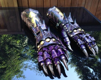 Dragon gauntlets made with leather and brass