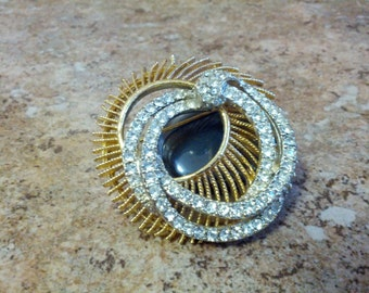 Beautiful BSK signed Circular brooch set with gold tone metal and shiny clear crystals