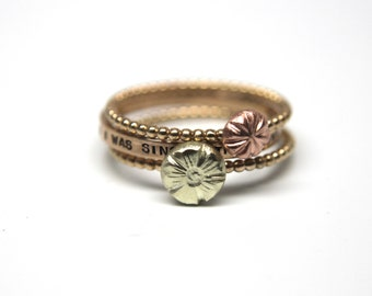 Set of Three Cherry Blossom Rings in 14k Gold. Simple stacking rings in 14k rose gold, yellow gold, white gold, green gold. Thin gold rings.