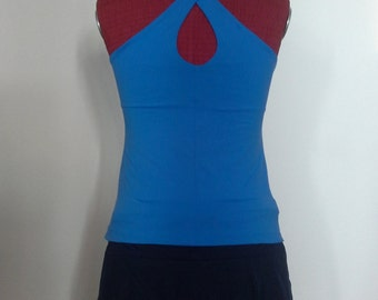 Tennis court with full tank top and blue skirt with elastic tulle
