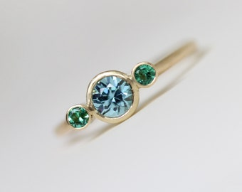 Delicate Blue Zircon Green Emerald Engagement Ring 14k Yellow Gold Modern Simple 3 Bezel Bridal Design Underwater Ocean Colors - Jewel Sea