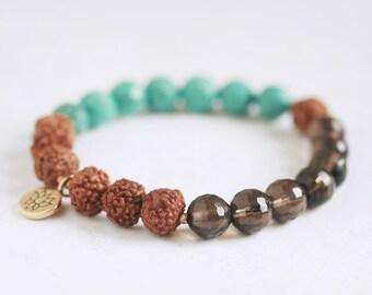 Rudraksha seed bracelet with Faceted Turquoise, Smoky Quartz, Lotus Blossom Charm