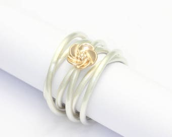 Coiled ring silver with blossom of red gold