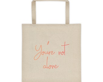 You're Not Alone Tote bag