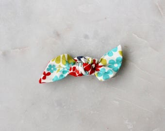 Knotted bow in bright colors