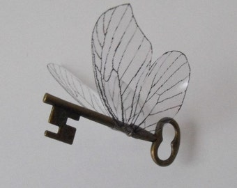 Flying 'magical' key with large butterfly wings in antique brass - ASBF