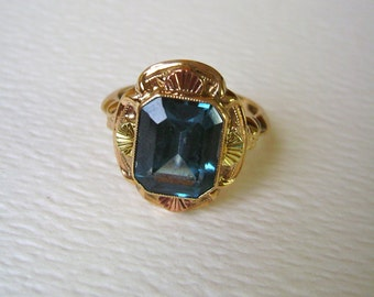 art deco ring in 10k rose, green, and yellow gold, blue stone