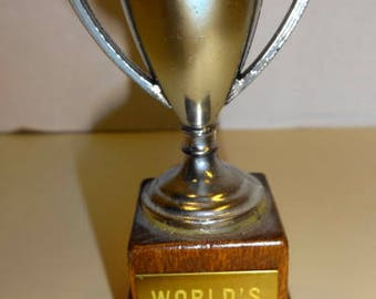 """1960s """"World's Greatest Doll"""" Trophy. 4"""" tall. Plastic on wood base.. MINT Condition"""