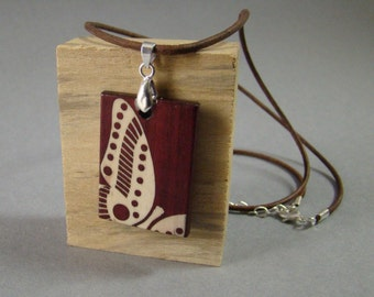 Pendent of purpleheart with holly butterfly inlay. FREE SHIPPING.
