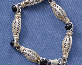 Vintage Sterling Bracelet, designers, marked C.F. 925 with black Onyx stones