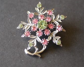 Silver tone flower brooch with pink and green rhinestones