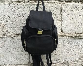 Vintage Backpack/ 90s/ five pockets/ black color/ adjustable straps/ nylon/ 20 cm x 17 cm