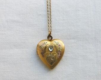 Gold filled heart locket set with a tiny diamond