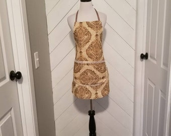Bib style apron. Made very durable to last. Great for cooking, baking, and grilling.