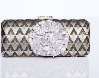 Silver and black hard shell clutch