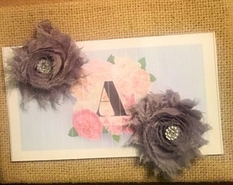 Gray 2 pk of shabby flower clips with  rhinestone flower centers on matching gray ribbon lined alligator clips