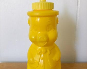 vintage yellow plastic mustard pig