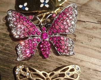 Lot of three butterfly brooches