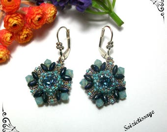 Dangling earrings beads woven around a cabochon blue denim swarovski crystal