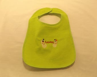 Days of the week with different vegetable baby bibs.