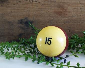 Vintage phenolic billiard fifteen ball, 2 1/4 inch no. 15 striped resin pool ball