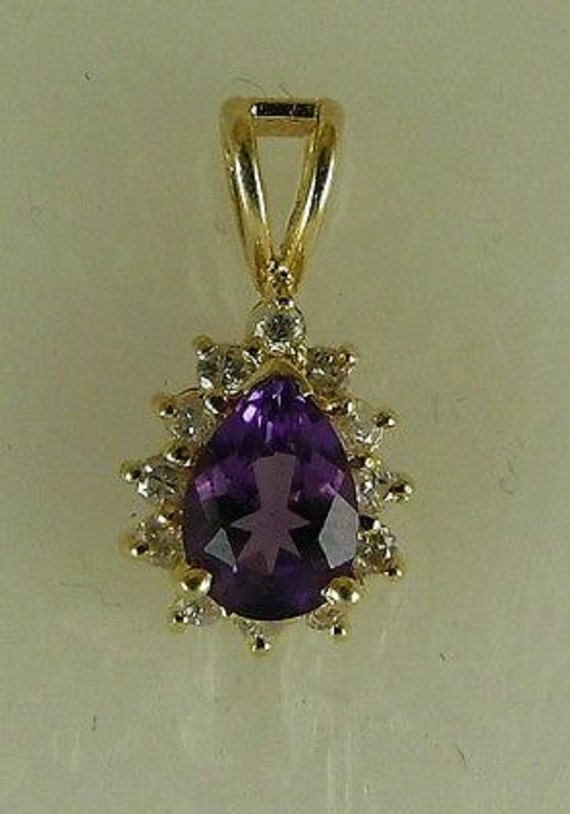 Amethyst 0.75ct Pendant with 14K Yellow Gold & Diamonds 0.18ct