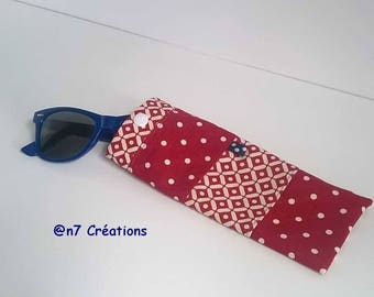 Red and ecru, glasses case with geometric patterns.