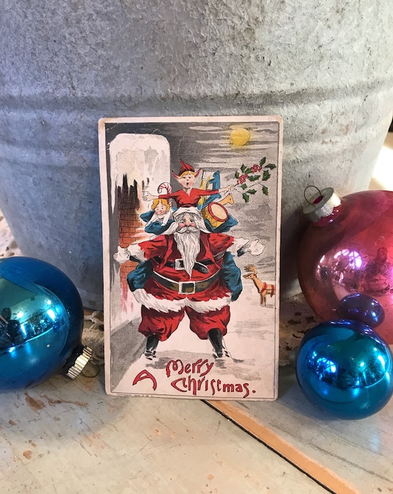 1908 Santa Postcard w Elf Toys Reindeer & more Christmas Greetings unsent