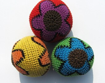 With flower pattern juggling balls.